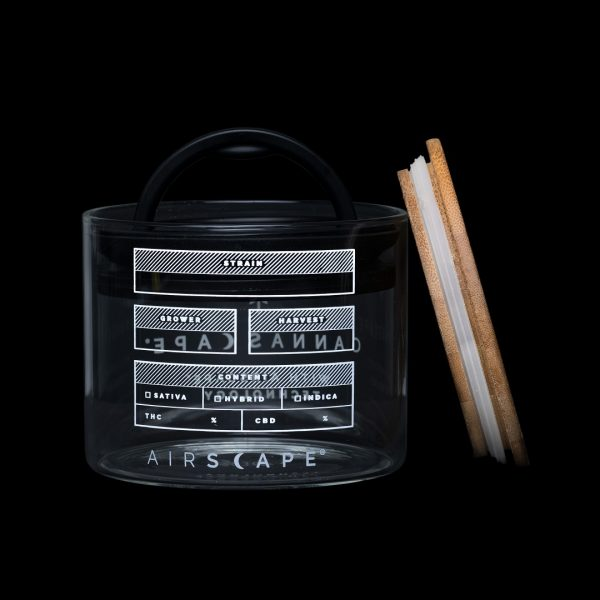 Photo of back side of Cannascape Glass storage canister on a black background