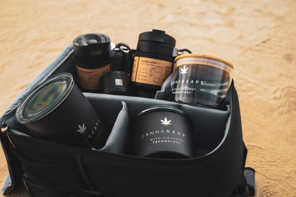 Photo of Cannascape storage canisters and BruTrek coffee gear in a backpack